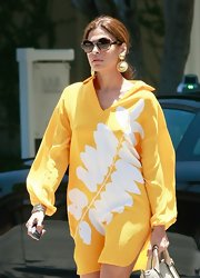 Eva Mendes took an LA stroll sporting a pair of gold dangle earrings shaped like the sun.