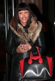 Eve stepped out in New York City carrying a chic red and black leather tote.