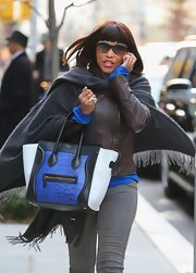 Eve strolled around New York City looking chic with her Celine tote and cateye sunnies.