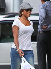 Eve tried to keep a low profile with a gray ivy cap and a pair of sunglasses as she shopped in New York.