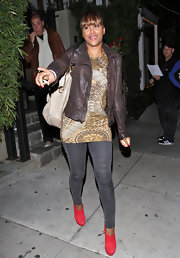 Eve gave her street wear a vibrant finish with red suede ankle booties.