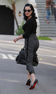 Dita Von Teese worked a pair of cropped gray trousers with tuxedo-style trim.
