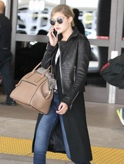 Gigi Hadid stepped out of LAX toting a stylish beige Marc Jacobs bag.
