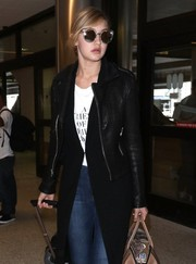 Gigi Hadid hid her eyes behind a pair of ultra-modern sunnies by Quay as she arrived at LAX.