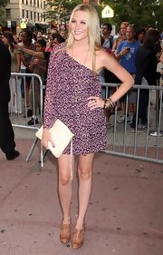 Stephanie opted for a flowing, one-shouldered, print dress with tan clogs and stacked bangles.