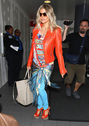 Fergie arrived at the airport in head-to-toe brights featuring matching strappy sandals and motorcycle jacket.