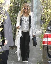 A pair of black wide-leg pants dressed up Fergie's evening look while out in LA.