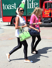Alesha Dixon complemented her casual get-up with a stylish mint-green bowler bag while out and about in Santa Monica.