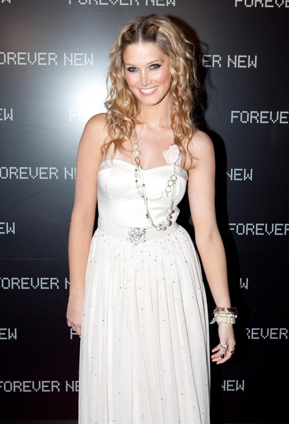 Delta showed off her sweet side in flowing curls and a heavenly white dress.
