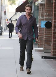 Gerard Butler donned a loose-fitting button-down top while running errands in Beverly Hills.