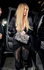 Khloe Kardashian paired a Chanel sequined clutch with a racy outfit for Gigi Hadid's birthday party.