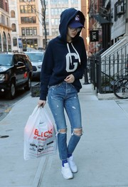 Gigi Hadid teamed her sweater with a pair of ripped jeans.