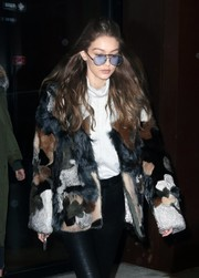 Gigi Hadid cut a stylish figure in her light-blue aviators and fur jacket while out in New York City.