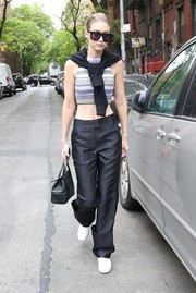 Gigi Hadid teamed her cute top with a pair of charcoal slacks.