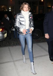 Gigi Hadid was space age-chic in a silver puffer jacket by Tommy Hilfiger while enjoying a night out in New York City.