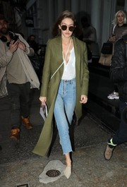 Gigi Hadid was casual-chic on the streets of New York City in a military-green Zimmermann wool coat teamed with a henley shirt and cropped jeans.