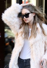 Gigi Hadid accessorized with ultra-modern shades by Elizabeth and James for a day out in New York City.
