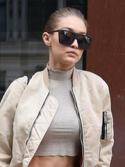 Gigi Hadid went for bold styling with a pair of oversized square shades by Karen Walker.