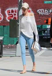Gigi Hadid took a stroll in New York City rocking a tattered white boatneck sweater.