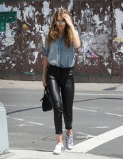 Gigi Hadid's black Unravel leather pants worked stylishly with her denim shirt.