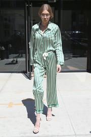 Gigi Hadid turned heads when she stepped out in New York City wearing a green and white striped pajama top by Morgan Lane.