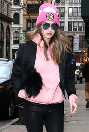 Gigi Hadid's pink and white Animewild beanie gave her look a lively punch.