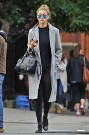 Gigi Hadid looked like she was headed to ballet class in her wool coat, leotard, and tights combo.