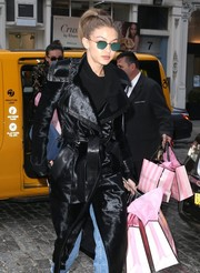 Gigi Hadid stepped out in New York City rocking a pair of green shades by Krewe.