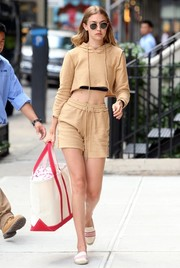 Gigi Hadid completed her sporty-cute attire with a pair of drawstring shorts, also by Danielle Guizio.