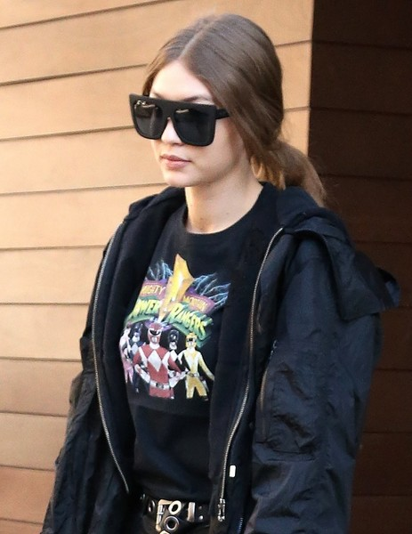 Gigi Hadid went for edgy styling with a pair of oversized top-heavy shades.