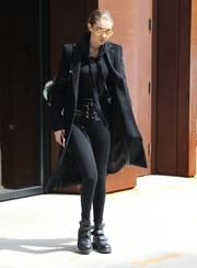 Gigi Hadid headed out in New York City sporting black lace-up leggings and a matching hoodie, both by Are You Am I.