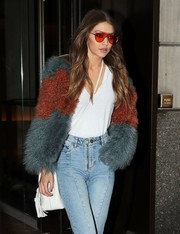 Gigi Hadid's white Re/Done tank top and color-block fur coat were a very cool pairing!