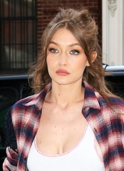 Gigi Hadid was seen out in New York City wearing a glamorous half-up hairstyle.