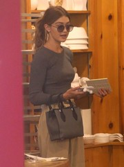 Gigi Hadid was spotted out in New York City carrying a small gray Michael Kors tote.