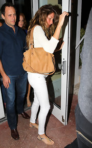 A pregnant Gisele took a break from the high heels and instead opted for a pair of chic flat sandals.
