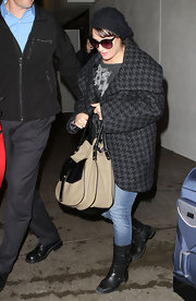 Lea wears a thick hounds-tooth coat at LAX.