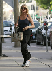 Goldie Hawn pampered herself at the nail salon carrying a classic plaid Burberry bag.