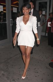 Nia looked ultra sexy in her white wrap dress while heading to the premiere of 'Good Hair'.