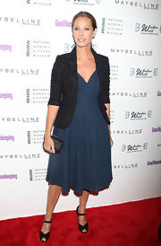 Christy Turlington teamed her blue full-skirted dress with black ankle strap peep-toes.