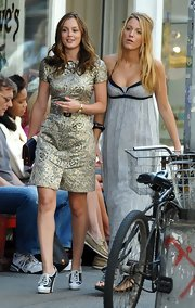 Leighton is wearing a pair of black and white heeled brogues.