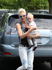 Gwen has a couple of charms hanging from her gold chain necklace.