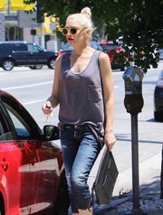 Gwen Stefani went shopping carrying an edgy black leather clutch by L.A.M.B.