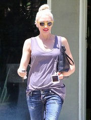 Gwen Stefani looked funky, as usual, in yellow Steven Alan shades while out shopping.