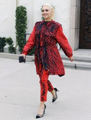 Gwen Stefani looked striking in a red and black printed parka by Moschino while attending church.