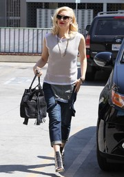 Gwen Stefani dressed up her casual outfit with ultra-stylish two-tone gladiator heels.