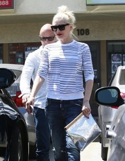 Gwen Stefani stopped by an acupuncture studio wearing a pair of modern square sunnies.