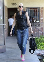 Gwen Stefani was biker-chic in a sleeveless black zip-up top and boyfriend jeans while visiting an acupuncture studio.