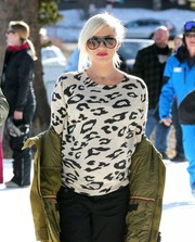 Gwen Stefani looked sporty-chic wearing a pair of designer shield sunglasses.