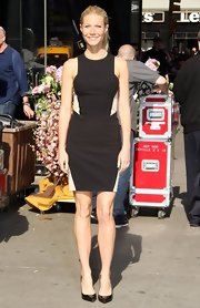 Gwyneth Paltrow rocked this black sleeveless dress with nude illusion paneling.