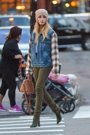 Hailey Baldwin was grunge-chic in a Made Gold denim jacket with plaid sleeves while out and about in New York City.